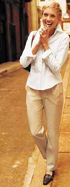 Woman standing in street in Dockers Metro Trousers